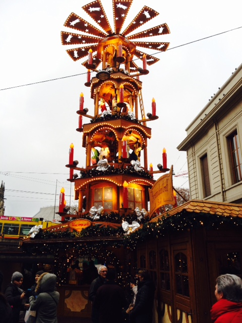 "A gorgeous ""Christmas Pyramid"" at the Basel Weihnachtsmarkt. Did you know it is thought these might have been the predecessors to Christmas trees?!?"
